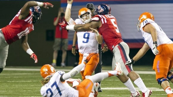 Boise State quarterback Grant Hedrick is hit byMississippi defensive tackle Robert Nkemdiche during an NCAA college football game, Thursday Aug. 28, 2014 in Atlanta. (AP Photo/The Idaho Statesman, Darin Oswald)  LOCAL TELEVISION OUT (KTVB 7); MANDATORY CREDIT