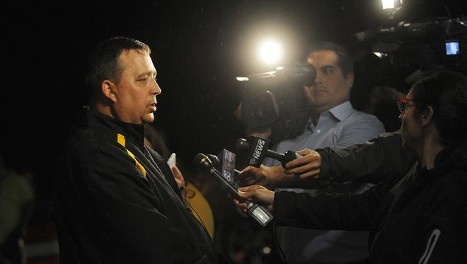 St. Lawrence County Sheriff Kevin M. Wells addresses the media Thursday night, Aug. 14, 2014 in Heuvelton after Fannie Miller, 12, and her sister Delila Miller, 6, were returned home safely after being abducted the night before.