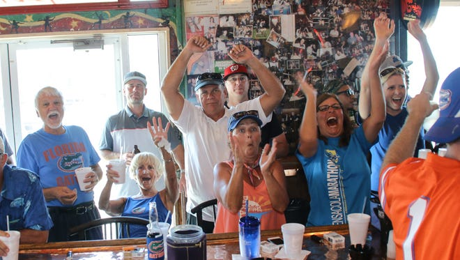 Area Florida Gators fans, shown cheering at a watch party last year, can gain insight into new season at annual Gator Gathering Thursday at Seville Quarter