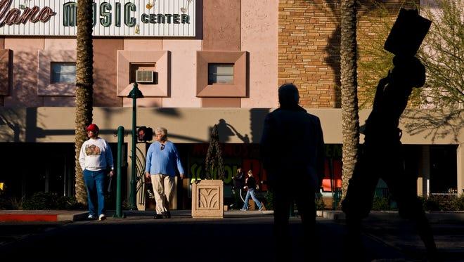 People walking around downtown Mesa.