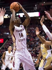 Mann (14) drives through the Georgia Tech defense for the FSU Men's Basketball Team on Wed, Jan 24th at the Donald L. Tucker Center.