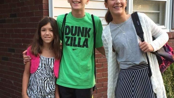 Noah Lorencovitz with his sisters, Camryn (left) and Morgan (right).