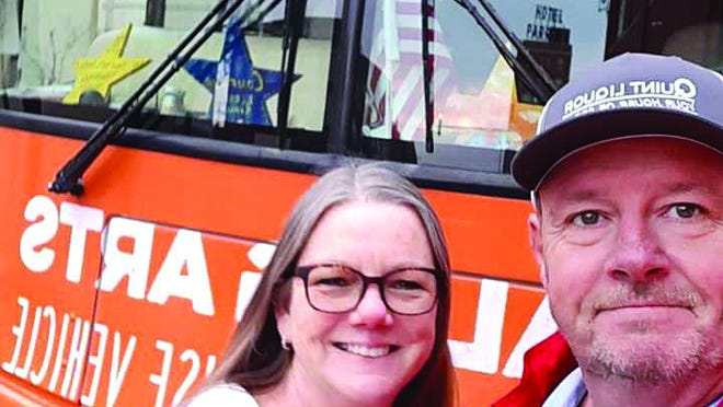Matt Deighton stops for a selfie with Pratt business owner Cathy Abbott on April 30, 2020, in front of the Stars of Hope bus. Deighton and Jeff Parness travel around the country giving hope to others in memory of the Greensburg tornado of 2007.