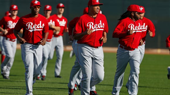 (From left) Aroldis Chapman, Alfredo Simon and Johnny Cueto run sprints during spring training in Goodyear in February.