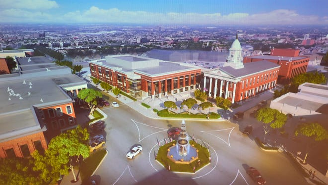 Computer illustrations of the proposed courthouse are on display during the Franklin County Court Facility Improvement Project open house on Thursday, January 11, 2018 at the county annex.