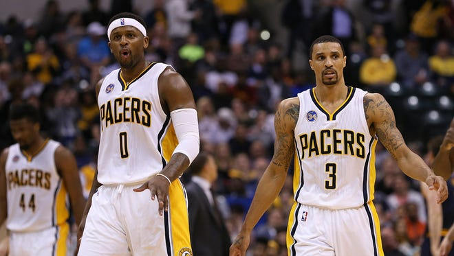Indiana Pacers forward C.J. Miles (0) and Indiana Pacers guard George Hill (3) are confident in the second half of the game at Bankers Life Fieldhouse, Indianapolis, Wednesday, April 6, 2016. The Pacers won, 123-109. The Pacers won, 123-109.