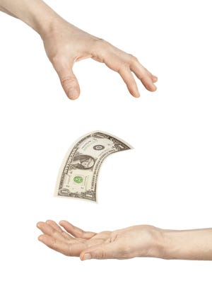 Getty Images/iStockphoto Change hands of money