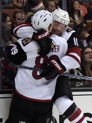 Oct.14, 2015; Anaheim Arizona Coyotes center Max Domi (16) celebrates with left wing Mikkel Boedker (89) after scoring a goal in the first period against the Anaheim Ducks at Honda Center.