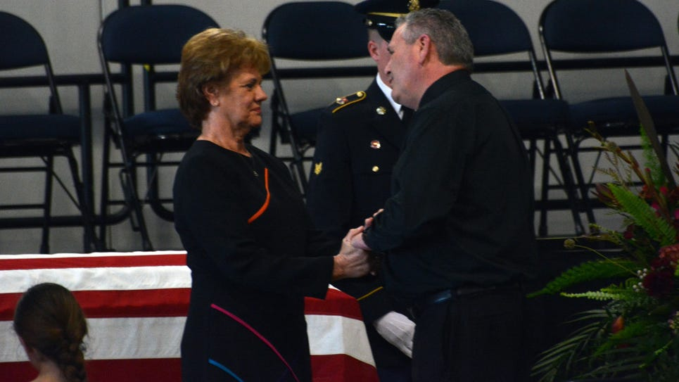 ANI Strother Wake The Rev. Craig Scott (right) visits with Sara Strother (left), mother of the late National Guardsman CW4 David Strother, at a visitation held Wednesday, March 25, 2015 at the Alexandria Riverfront Center.-Melinda Martinez/mmartinez@thetow