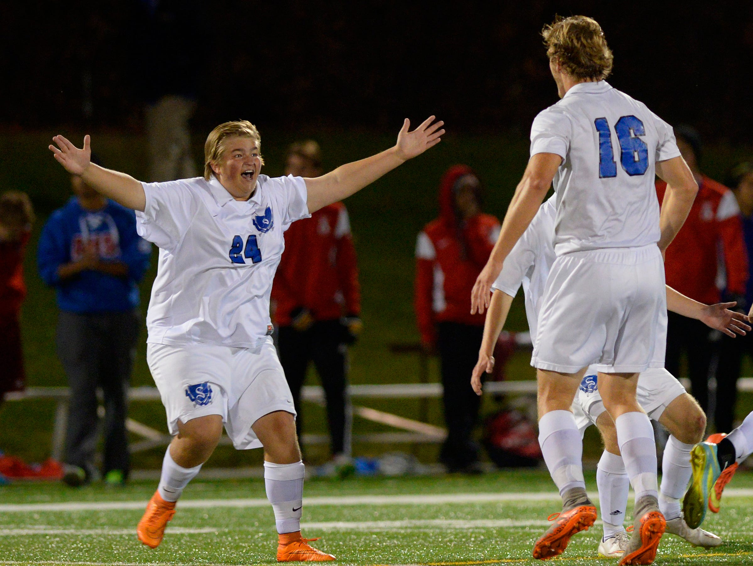 Sartell's Trevor Erickson (24) and Ethan Kiffmeyer (16) celebrate their 2-1 win in their Sect. 8A championship game against St. Cloud ApolloThursday, Oct. 22 at Husky Stadium. Sartell secured a state tournament appearance with the win.