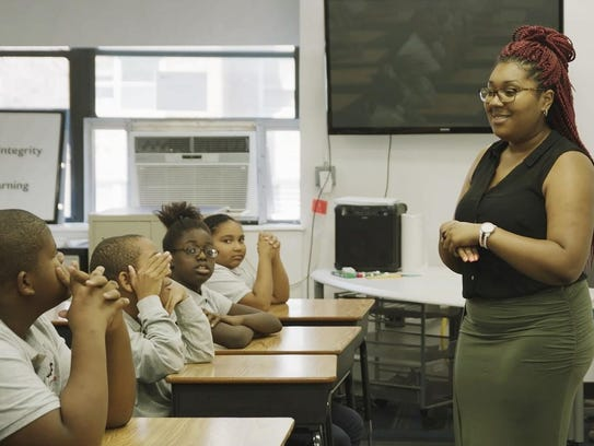 A Brooklyn Lab teacher speaks to her students