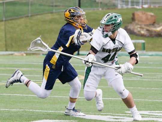 Pequannock's Matt Gallo defends as Montville's Kyle