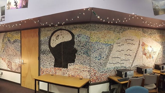 The final product of the 30 foot long mosaic mural students made for the Fowlerville Junior High School library.
