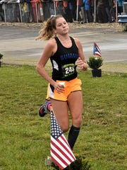 Catherine Coldiron heads down the home stretch for