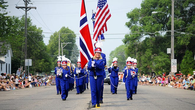 The Store Bergan Skolekorps school band from Norway performs a set during the Fourth of July Parade in St. Joseph on Saturday. The band is performing in the parade as part of its Minnesota tour.