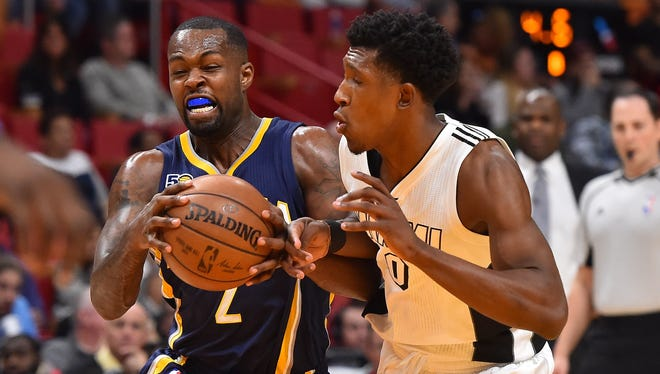 Indiana Pacers guard Rodney Stuckey (2) drives the ball around Miami Heat guard Josh Richardson (0) during the first half at AmericanAirlines Arena.