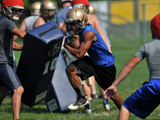 Lancaster High School senior Harrison Taylor runs a play during the Golden Gales' practice Friday morning, Aug. 1, 2014, in Lancaster.