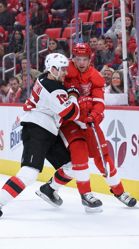 New Jersey Devils right wing Drew Stafford (18) hits