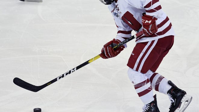 Wisconsin's Abby Roque (18) works the puck during the first period in the NCAA Division I women's Frozen Four hockey championship game against Minnesota, Sunday, March 24, 2019, in Hamden, Conn.