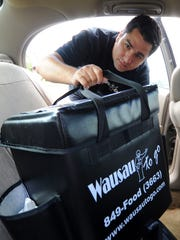 Zakaria Khandakani, of Wausau To Go, makes his delivery Wednesday, July 13, 2011, at Domtar in Rothschild.