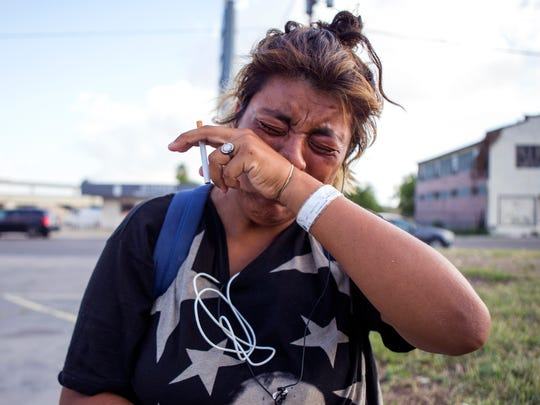 """Mercedes Mendoza arrives at the scene where Corpus Christi police are investigating the death of her best friend """"Floyd"""" outside the EZ Stop convenience store on Leopard Street on Thursday, May 31, 2018. """"He's my best friend, he never bothered anyone,"""" Mendoza said."""