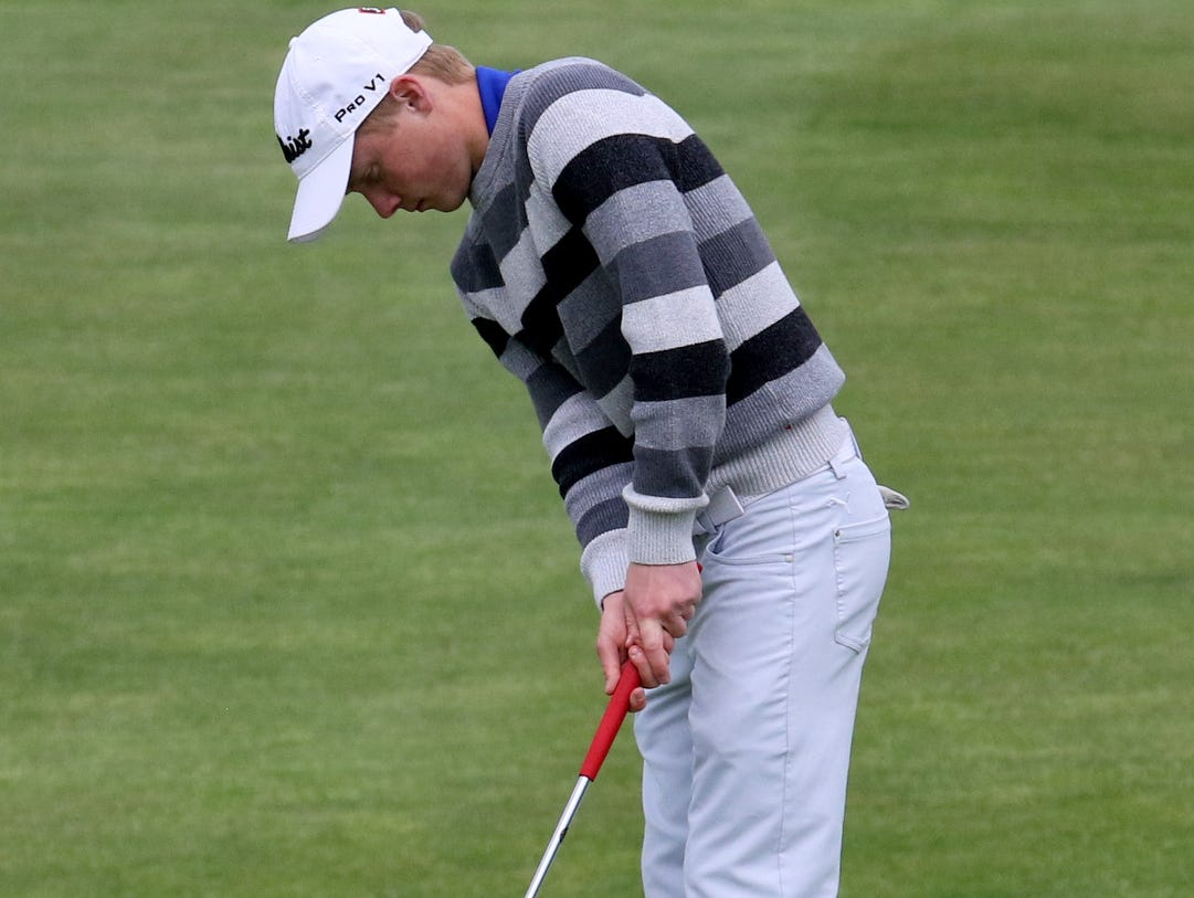 Trumansburg's Danny Lapp putts on the 18th hole Wednesday during the Interscholastic Athletic Conference golf championships at Soaring Eagles Golf Course in Horseheads. Lapp was medalist with a 78.