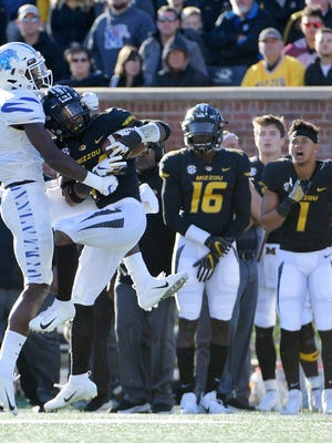 Missouri cornerback Adam Sparks intercepts a pass intended for Memphis Tigers wide receiver Kedarian Jones in a 2018 game. Sparks and Jarvis Ware are listed as starters at cornerback for Mizzou now but are expected to be challenged for playing time by several young players, including top recruit Ennis Rakestraw.