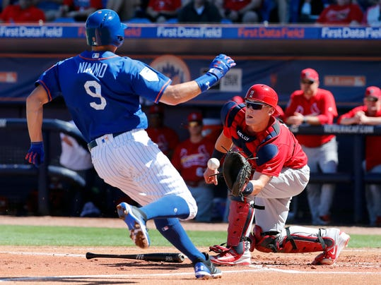 New York Mets' Brandon Nimmo (9) is forced out at home by St. Louis Cardinals catcher Carson Kelly during the first inning of an exhibition spring training baseball game Saturday, Feb. 24, 2018, in Port St. Lucie, Fla. (AP Photo/Jeff Roberson)