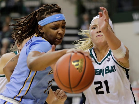 Green Bay Phoenix guard/forward Jessica Lindstrom (21) goes for a rebound against Marquette Golden Eagles guard Allazia Blockton (11) in a women's NCAA basketball game at the Kress Center on Saturday, December 2, 2017 in Green Bay, Wis.  