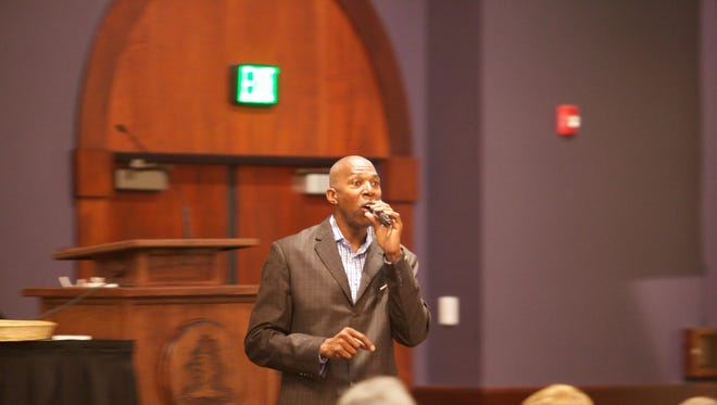 Thurl Bailey speaks to the audience at the Utah Rural Summit on Friday at Southern Utah University.