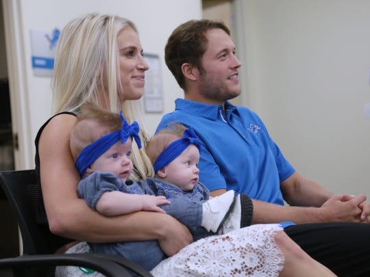 Lions quarterback Matthew Stafford and his wife Kelly B. Stafford listen with their twins, Sawyer and Chandler Stafford, during a press conference in Allen Park on Aug. 29, 2017. The Lions and Matthew Stafford agreed to a $135 million, five-year contract extension.