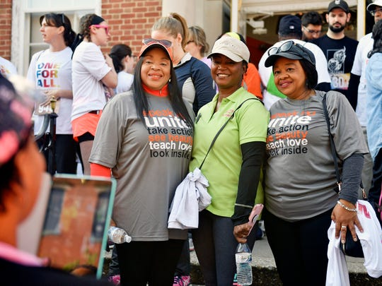 From left, Carolyn Dow, Sandra Thompson and Sandra Harrison pose for a group photo by friend Candace Robinson before participating in YWCA York's 12th Race Against Racism 5K race Saturday, April 28, 2018, in York. About 600 people participated in the annual race, which featured a wave of timed runners as well as color splash stations for interested participants. The annual event, which benefits the YWCA York, opened with a pledge to end racism. Dow, Thompson and Harrison were three of five women who said they were discriminated by ownership and staff at Dover Township's Grandview Golf Club on April 21. After being told they were not keeping the pace of play and being asked to leave, three of the five women left the course at the turn while ownership called the police.