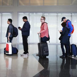 Patience urged as airport security lines grow