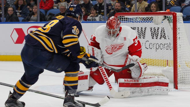 Sabres forward William Carrier (48) is stopped by Red Wings goalie Petr Mrazek (34) during the first period Friday in Buffalo, N.Y.