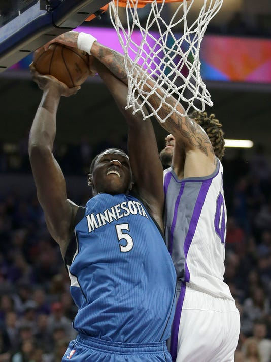 Sacramento Kings center Willie Cauley-Stein, right, blocks the shot of Minnesota Timberwolves forward Gorgui Dieng during the first half of an NBA basketball game, Monday, Feb. 27, 2017, in Sacramento, Calif. (AP Photo/Rich Pedroncelli)