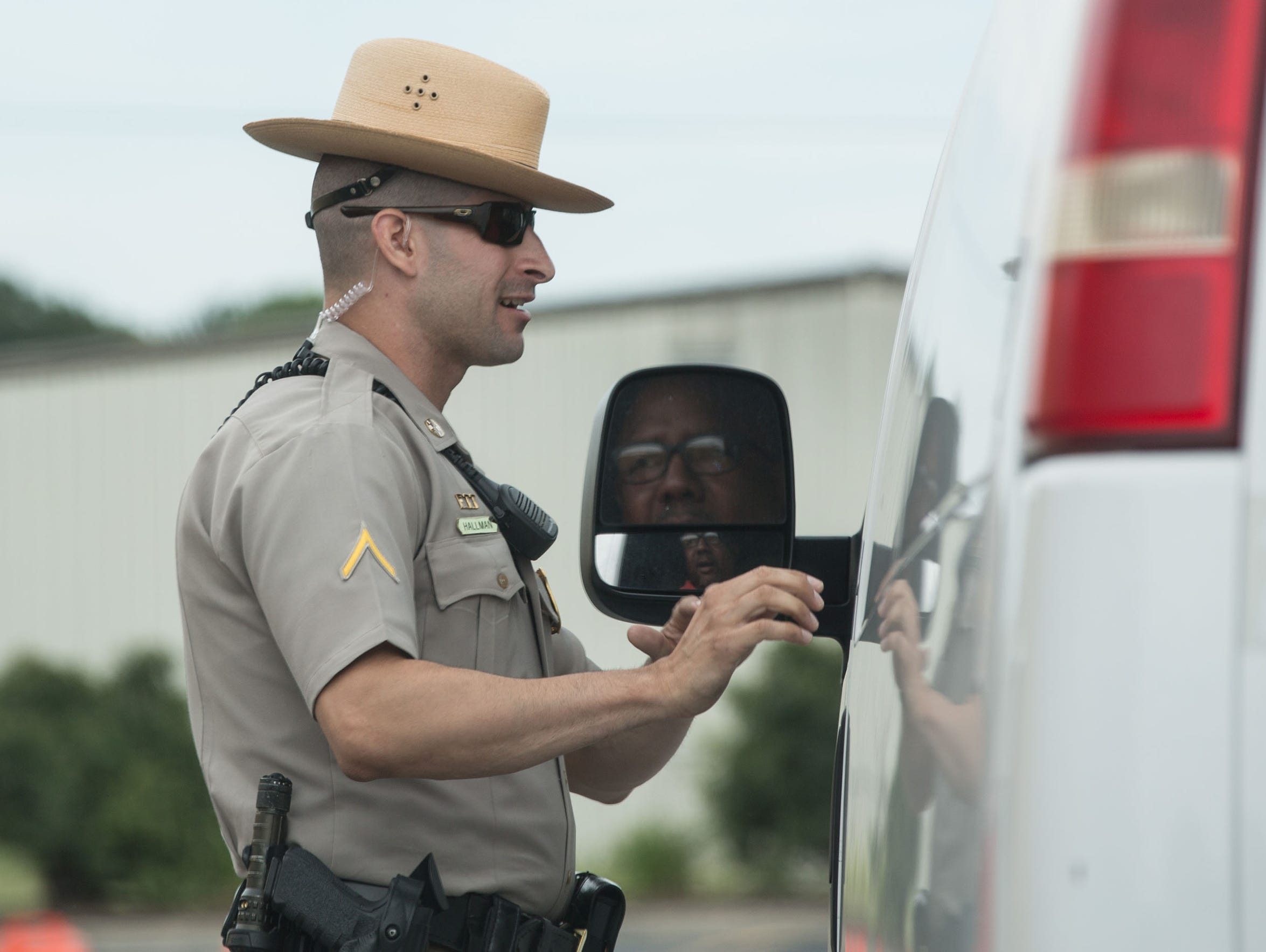 TFC Hallman, of the Maryland State Police, stops a