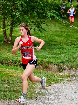 With a good bit of distance between her and the closest trailing runner, junior Kadence Shipers of the 2020 Chillicothe (Mo.) HS cross country running Lady Hornets strides up a gravel path in Chillicothe's Simpson Park Tuesday (Sept. 8) on her way to a 10th-place finish and personal fastest-ever time of 22:34.1 in the annual Chillicothe Invitational meet.