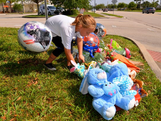 Laila Jerozal,6,  puts a stuffed rabbit at the accident