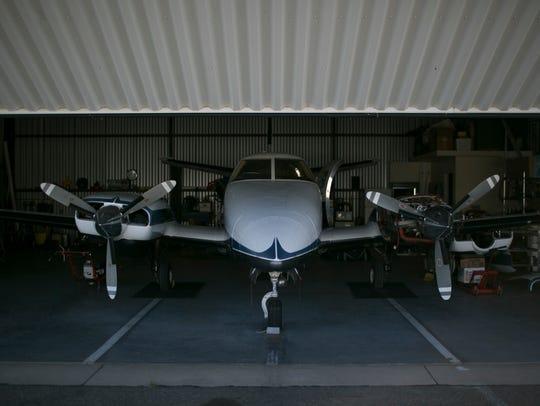 The garage door to Richard Goldman's hangar opens at