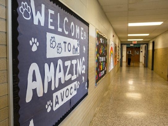 """Boards advocating the school's """"Amazing"""" theme hang"""