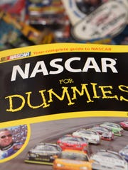 """A book titled """"NASCAR for Dummies,"""" part of Donna Brunow's NASCAR memorabilia collection."""
