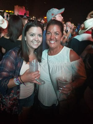 Red Land Senior High School graduate Kierstin Gallerie (left) and her mom, Deborah Raber, of Newberry Township, pose at the Route 91 Harvest Festival in Las Vegas. They were near the stage when a gunman opened fire from the 32nd floor of the Mandalay Bay hotel, killing 58 people.