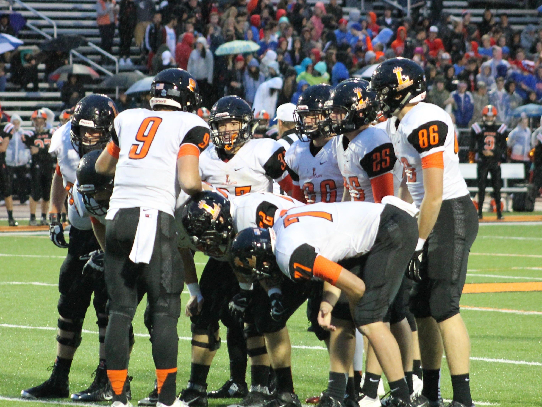 Staring at quarterback Drew Plitt (9) is Loveland junior Luke Waddell. Often the shortest guy on the field, he has rushed for more than 4,000 yards in three seasons.