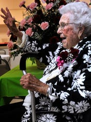 Ferne Lee waves a greeting as guests continue to arrive at the Baird Community Center Feb. 12. Family and friends me there to celebrate Lee's 100th birthday.