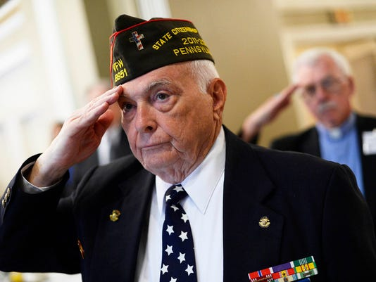 """Ron Herman, 2015 honoree, salutes as colors are presented during the 23rd annual Four Chaplains Prayer Breakfast at the Yorktowne Hotel Wednesday, May 13, 2015. Kate Penn â """" Daily Record/Sunday News"""