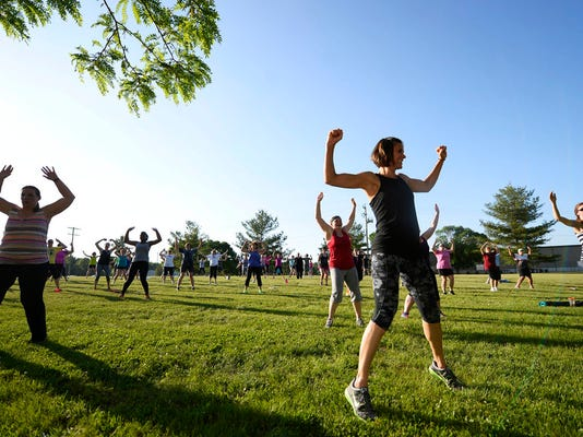 About 100 people kicked and punched along with Jen Kuhn as she led a kickboxing class during No Sweat in the Park at the York Daily Record/Sunday News in West Manchester Township Tuesday, May 19, 2015. Kate Penn -- Daily Record/Sunday News