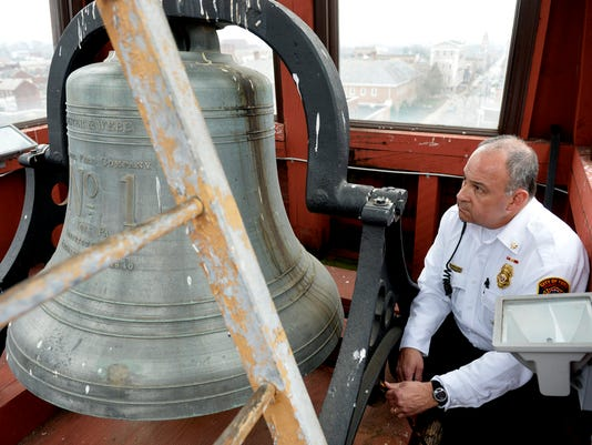 York City Fire assistant chief Pat Rose rings Station 1's bell at 3:15 p.m. to help commemorate the 150th anniversary of the end of the Civil War on Thursday, April 9, 2015. The fire station joined other community and church bells across York County and the nation in marking the moment. Chris Dunn Ñ Daily Record/Sunday News