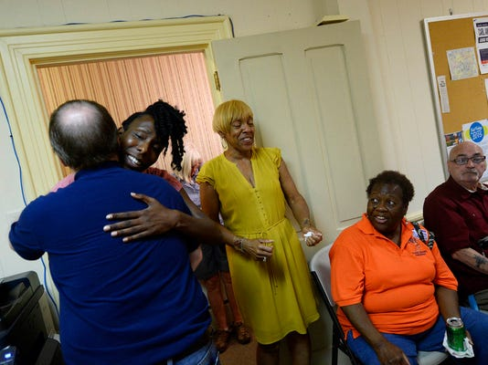 "Incumbent York city council person Carol Hill-Evans, center, and Sandie Walker celebrate their victories at the  York County democratic headquarters after the primary election Tuesday, May 19, 2015. Kate Penn â "" Daily Record/Sunday News"