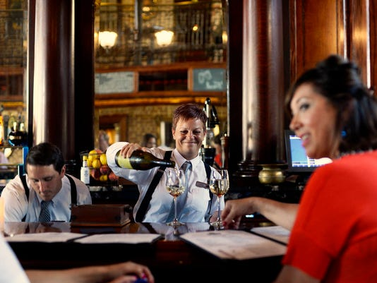 """Bartender Tricia Harrison pours drinks at The First Post, which recently opened in Springettsbury Township August 5, 2015. Kate Penn â """" Daily Record/Sunday News"""