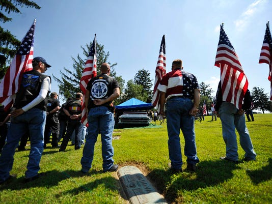 "Honor guard members hold flags during the graveside service for Cpl. Matthew Hanes at Mount Rose Cemetery Friday, August 14, 2015. Hanes, a 24-year-old veteran who had been paralyzed while serving in the military, was laid to rest after passing away due to a blood clot in his heart. Kate Penn â "" Daily Record/Sunday News"
